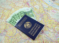 Free Passport With Money Over Map Stock Photo - 14192780