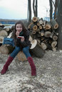 Free Girl Sitting On Logs With A Mobile Phone Stock Photo - 14197180