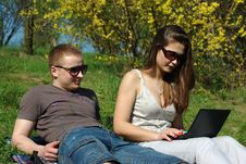 Young Couple With Laptop Outdoors Royalty Free Stock Photos