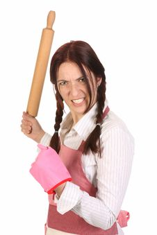 Mad Housewife With A Rolling Pin Royalty Free Stock Photography