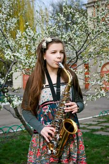 Free Beautiful Girl With Saxophone Stock Photography - 14192702