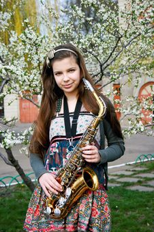 Free Beautiful Girl With Saxophone Royalty Free Stock Photo - 14192715