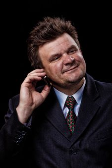 Businessman With Mobile Phone Speaking Royalty Free Stock Photography