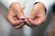 Holding Wedding Rings Stock Image