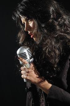 Free Female Vocalist On Black Royalty Free Stock Image - 14195166