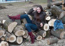 Free Girl Lying On Logs Royalty Free Stock Image - 14197436