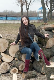 Free Girl On Logs Royalty Free Stock Image - 14197526