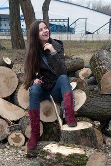 Girl Sitting On Logs Royalty Free Stock Photos