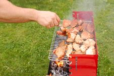 Free Man Turning Meat On A Barbecue Grill Stock Photos - 14198223