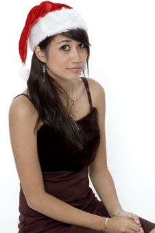 Free Cute Girl In A Santa Hat Royalty Free Stock Photos - 1420078