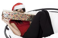 Free Cute Girl Hiding Beind Her Present Stock Image - 1420531