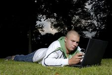 Boy With Notebook And Cell Phone In Park Stock Photo
