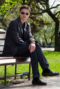 Free Guy With A Cigarette On A Bench In The Park Royalty Free Stock Images - 14201449