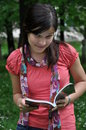 Free Beautiful Young Girl Reading A Book In The Natural Royalty Free Stock Photos - 14207928
