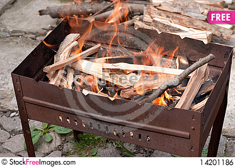 Brazier with burning wood Stock Photo