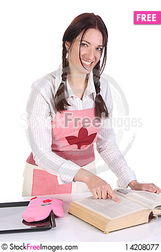 Free Housewife Preparing And Reading With A Book Recipe Royalty Free Stock Photography - 14208077