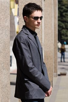 Free Man In Sunglasses Stands Near Office Building Royalty Free Stock Photo - 14201395