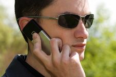 Young Man In Sunglasses Talks On The Phone Stock Images