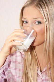 Woman In Bed With Glass Of Milk Royalty Free Stock Photo
