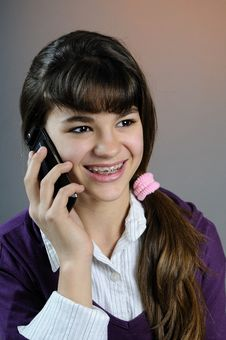 Girl Talking On Mobile Phone Stock Photography