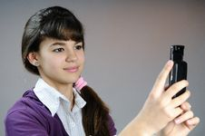 Teenager Making Photos With Mobile Phone Stock Image