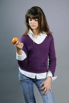Free Teenager Evaluating Healthy Fruit Stock Photography - 14205502