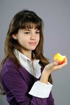 Free Beautiful School Girl Eating Healthy Fruit Royalty Free Stock Image - 14205636