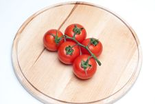 Tomatoes On Worktop Royalty Free Stock Photos