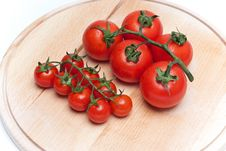 Tomatoes On Worktop Royalty Free Stock Images