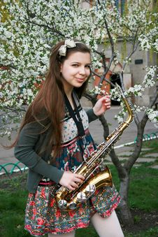 Beautiful Girl With Saxophone Stock Photos