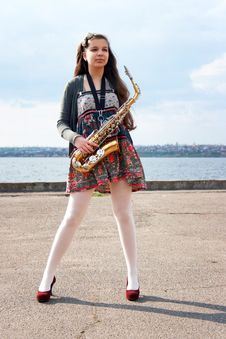Free Beautiful Girl With Saxophone Royalty Free Stock Image - 14208126