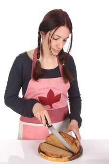 Free Beautiful Housewife Cutting Bread With Knife Royalty Free Stock Images - 14208969