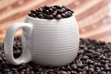 Free Coffee Beans In A Cup With Ethnic Mood Royalty Free Stock Photos - 14211958