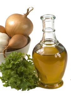 Free Bottle Of  Oil With Onion And Parsley Royalty Free Stock Images - 14212749