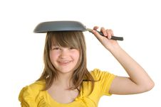 Free Girl Holds Frying Pan On Head And Smiles Royalty Free Stock Images - 14213829