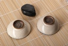 Dark Stone And Two Cup For Tea Royalty Free Stock Photos