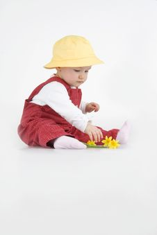 Free Sitting Little Girl In Hat And With Flower Royalty Free Stock Photos - 14213988