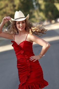 Free Cowgirl In Red Dress Royalty Free Stock Photo - 14215035