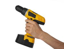 Free Battery Drill In Left Hand Royalty Free Stock Image - 14215136