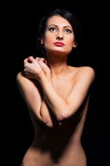 Young Woman With Hands Over The Torso Stock Photo