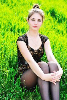 Free Elegant Girl Sitting In Grass Royalty Free Stock Image - 14219696