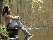 Girl Resting Near Lake Stock Photography