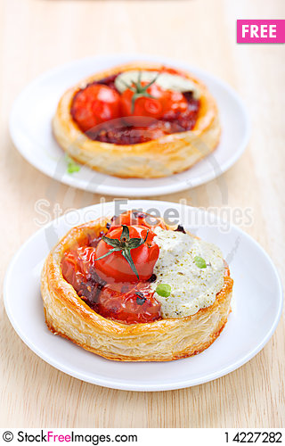 Tartlets with cherry tomatoes Stock Photo