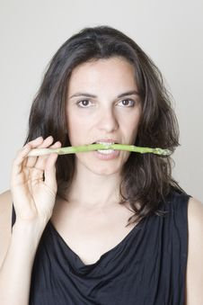 Free Woman Biting Asparagus Stock Photos - 14220383