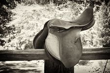 Horse Saddle On Wood Fence Stock Photos