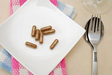 Free Medicine Capsules On Dining Plate Stock Photo - 14222320