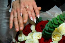Hands With Wedding Rings And Fowers Bouquet Stock Images