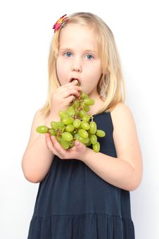 Free Beautiful Girl Eats Green Grapes Stock Photography - 14223272