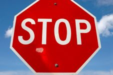 Stop Sign Against Blue Sky Stock Photo