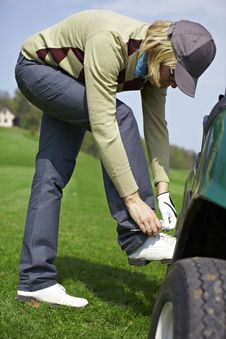 Free Woman Tying Shoes At The Golf Course Royalty Free Stock Photo - 14225845